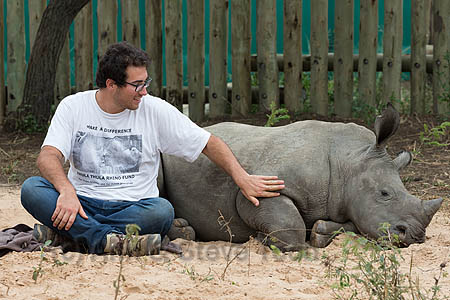 Ithuba, white rhino calf (Ceratotherium simum) orphaned by poaching, with carer Axel Tarifa, Rhino Response Strategy, Thula Thula rhino orphanage, KwaZulu-Natal, South Africa, May 2015